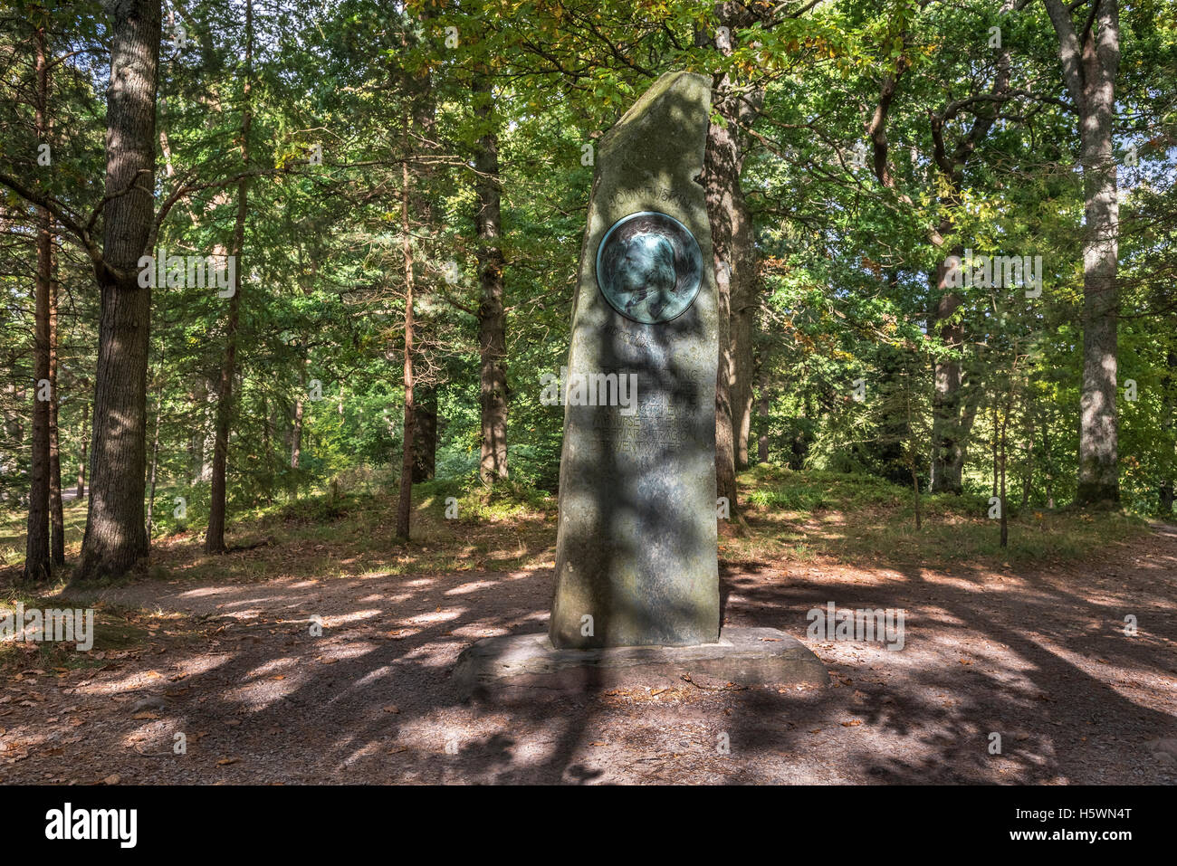 A stone pillar memorial to John Ruskin in the woods near Keswick. The Lake District Cumbria North West England. - Stock Image