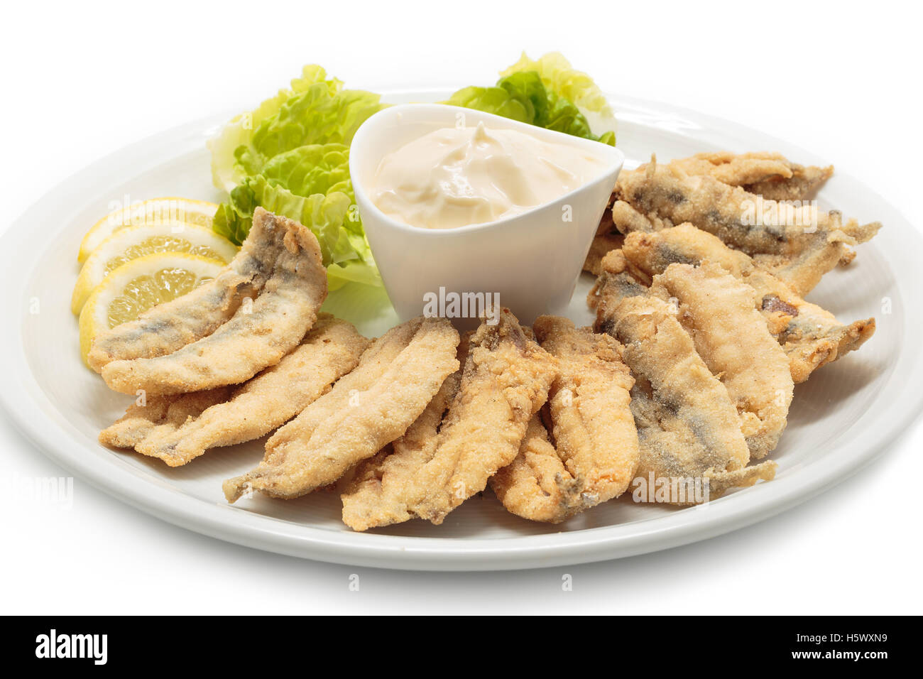 Fried anchovies with salad and mayonnaise - Stock Image