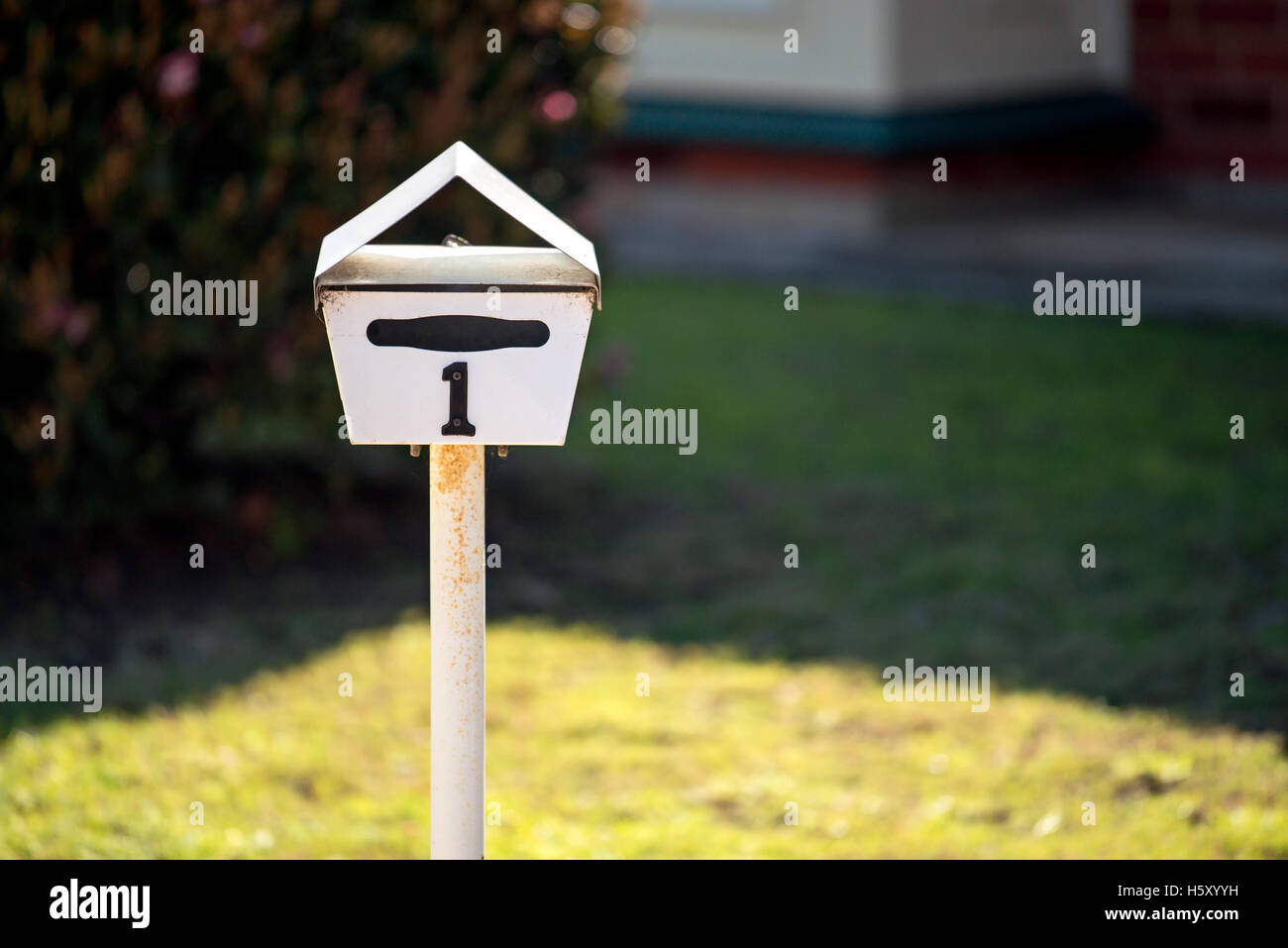 Australian home letterbox with number one on frontyard - Stock Image
