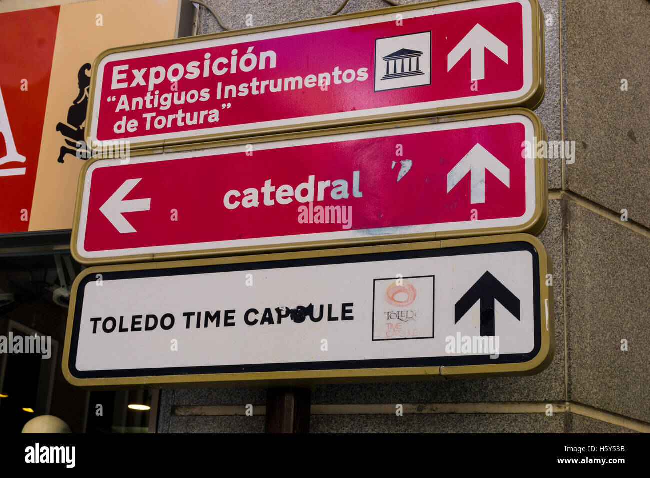 Direction signs for an exhibition of antique torture instruments, the cathedral, and the time capsule. Stock Photo