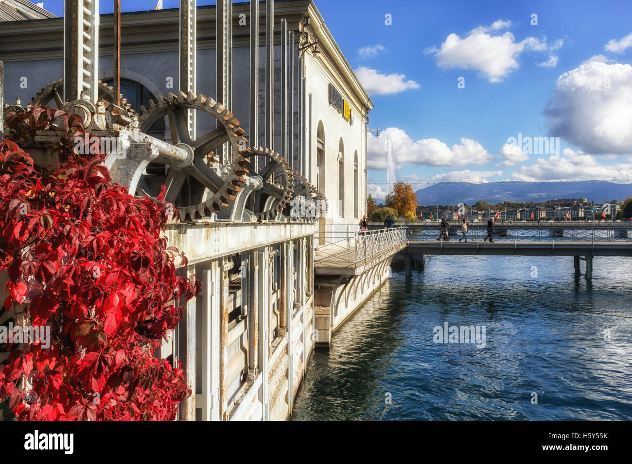 A view of the Geneva water jet from the building of the driving forces in Geneva, Switzerland. It is a tourist monument. - Stock Image