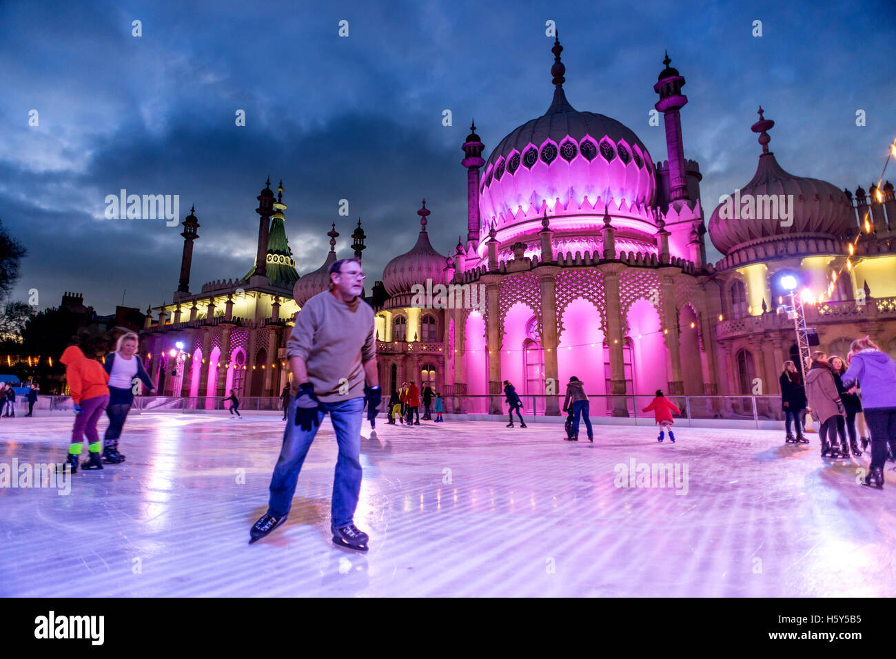Crowds enjoying the Brighton Pavilion Ice Rink, erected for the Christmas period each year. - Stock Image