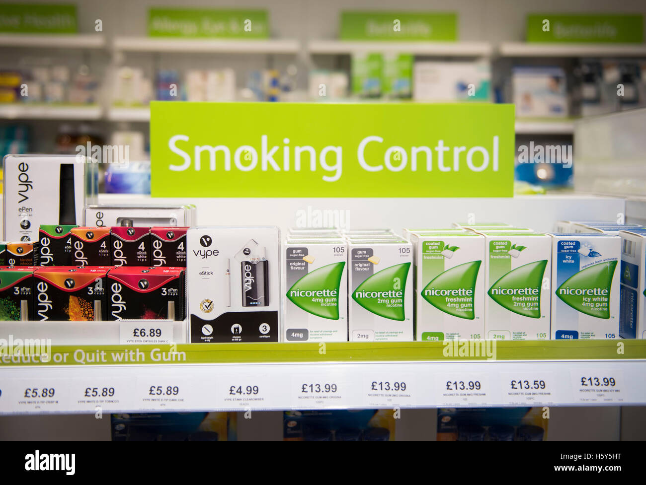 Nicorette quit smoking product patches and gum on sale on a shelf in a chemist store. - Stock Image