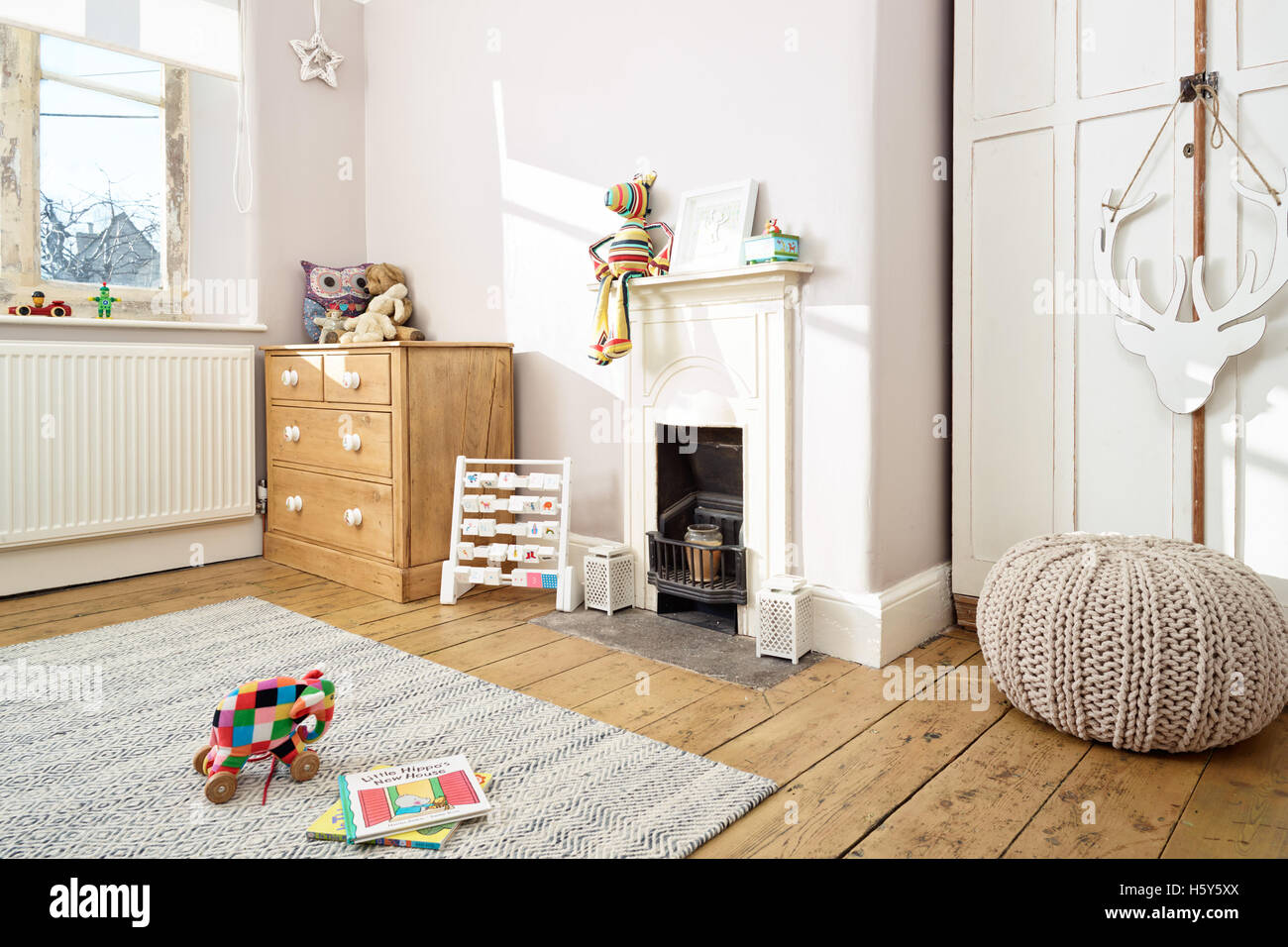A traditional child's nursery in a modernised British Victorian home - Stock Image