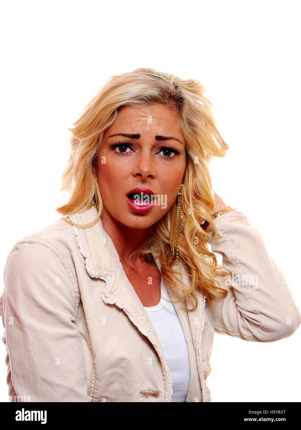 A image of a shocked, surprised, American caucasian, blond woman. - Stock Image