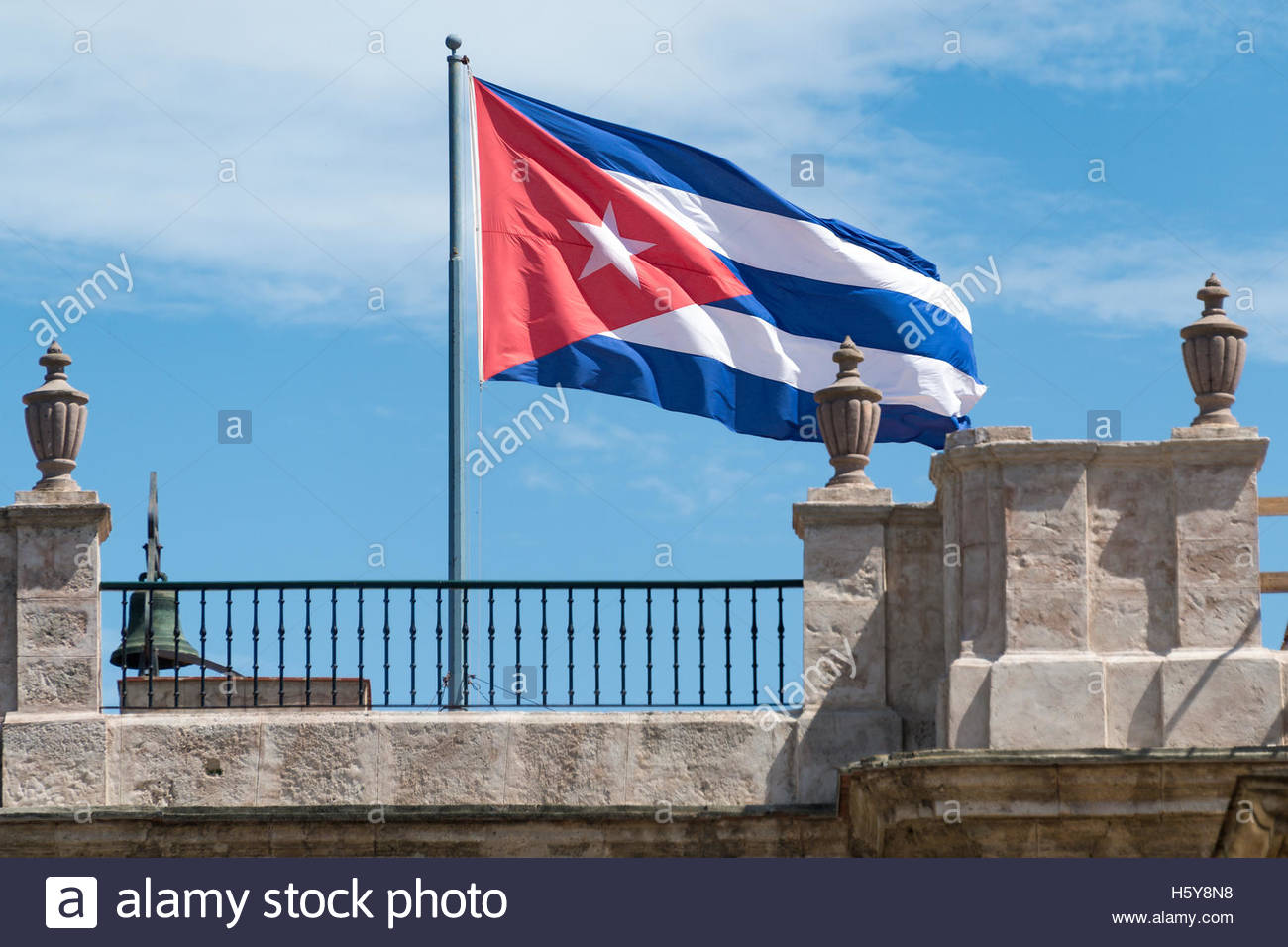 Cuban national flag on top of architecturally old building in Old Havana. - Stock Image