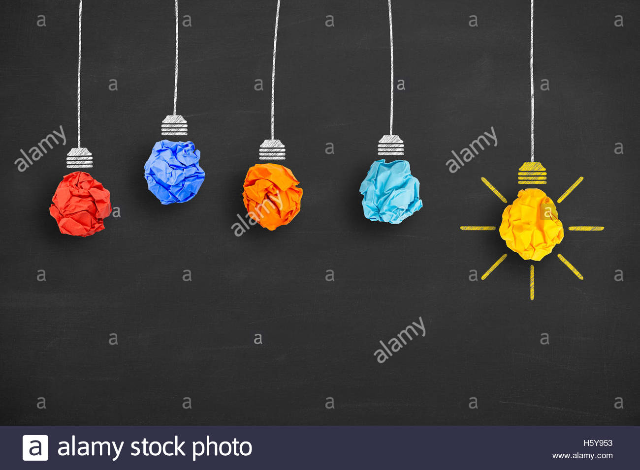 Crumpled Paper Light Bulb Idea Concept on Blackboard - Stock Image