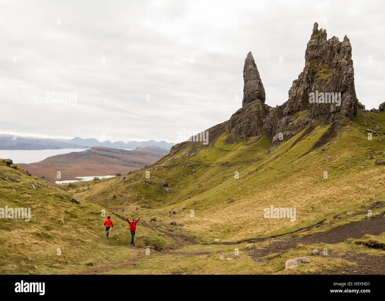 Old Man of Storr, Isle of Skye, Scottish Highlands - 22 October 2016: UK weather: young families making the most - Stock Image
