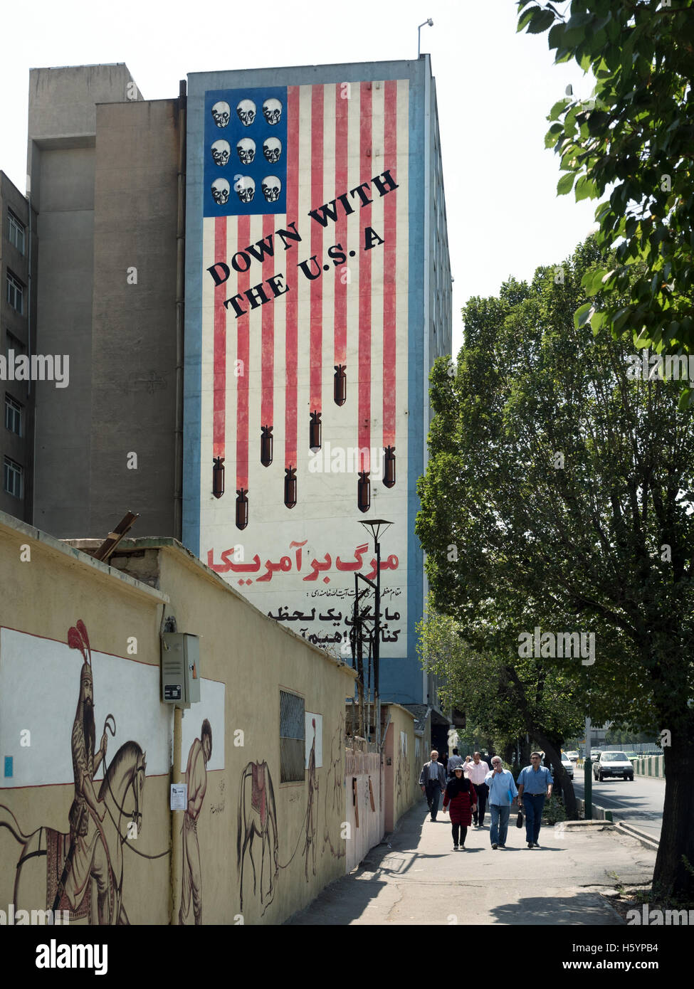 Tehran, Iran : a mural of the American flag featuring skulls and missiles instead of stars and stripes - Stock Image