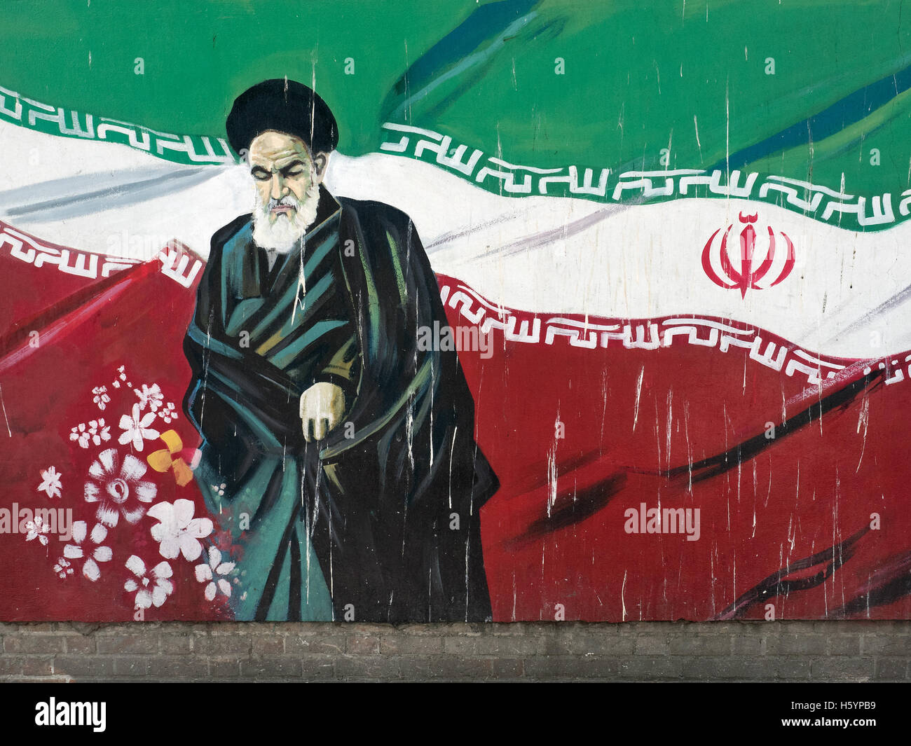 Ayatollah Khomeini and Iran flag mural, Tehran, Iran Stock Photo