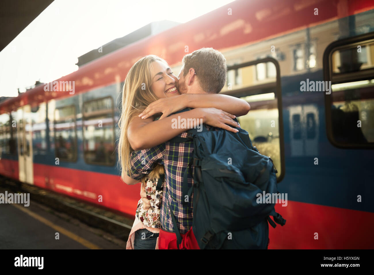 Beautiful couple hugging after long separation - Stock Image