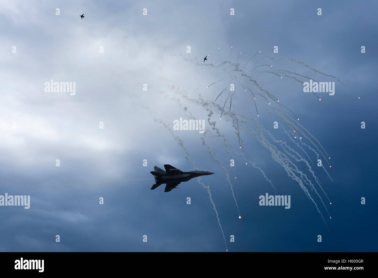 Air Strike. Fighter Jet in Dogfight. Aircraft in Battle Firing Defense Flares. War Zone. - Stock Image