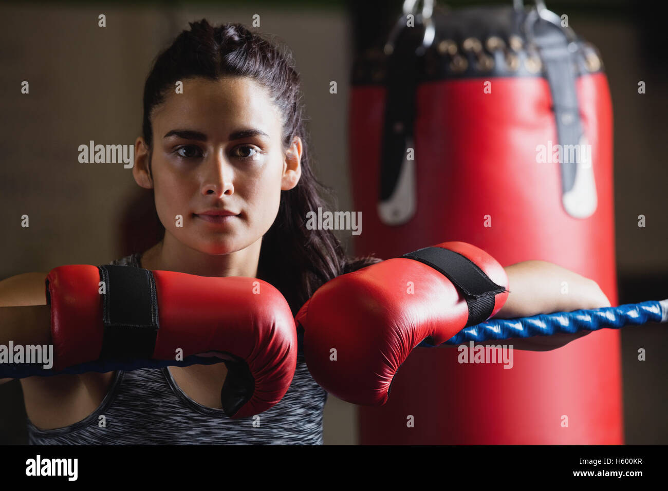 Portrait of female boxer in boxing gloves - Stock Image