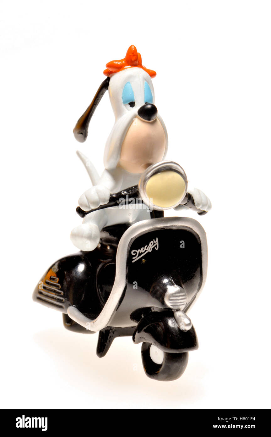 Cartoon character figurine - Droopy (MGM) riding a scooter - Stock Image