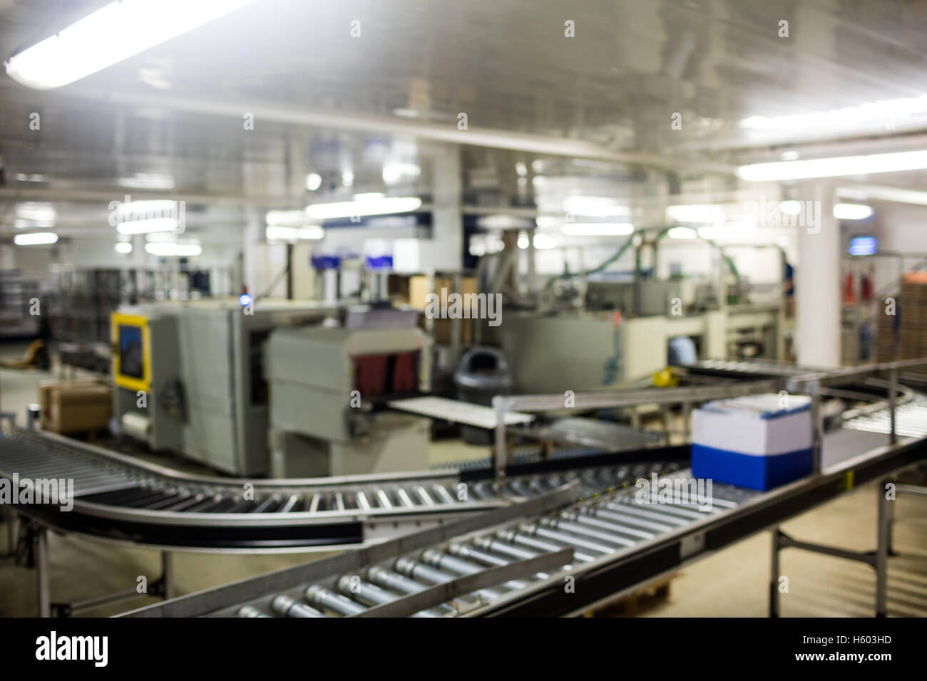 Box moving on production line - Stock Image