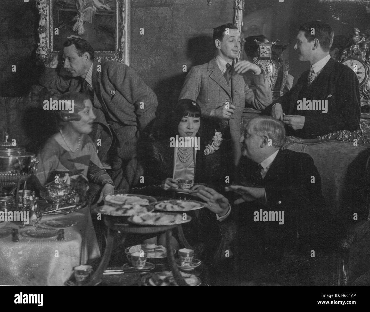 Anna May Wong, (centre table) born 3 January1905 to second-generation Chinese-American parents in Los Angeles. Considered - Stock Image