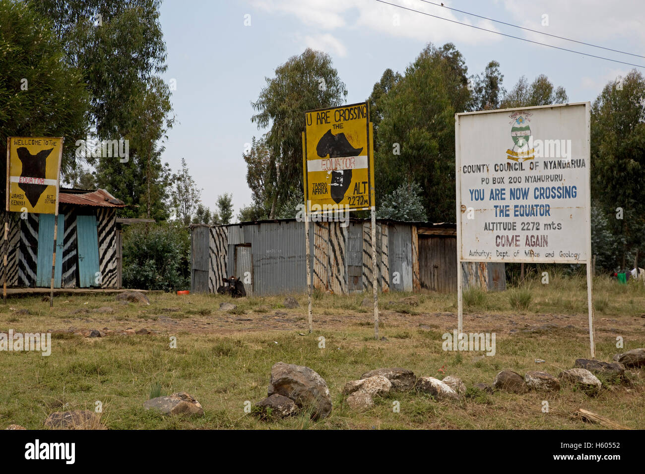 Equator signboards roadside near Nanuki Kenya - Stock Image