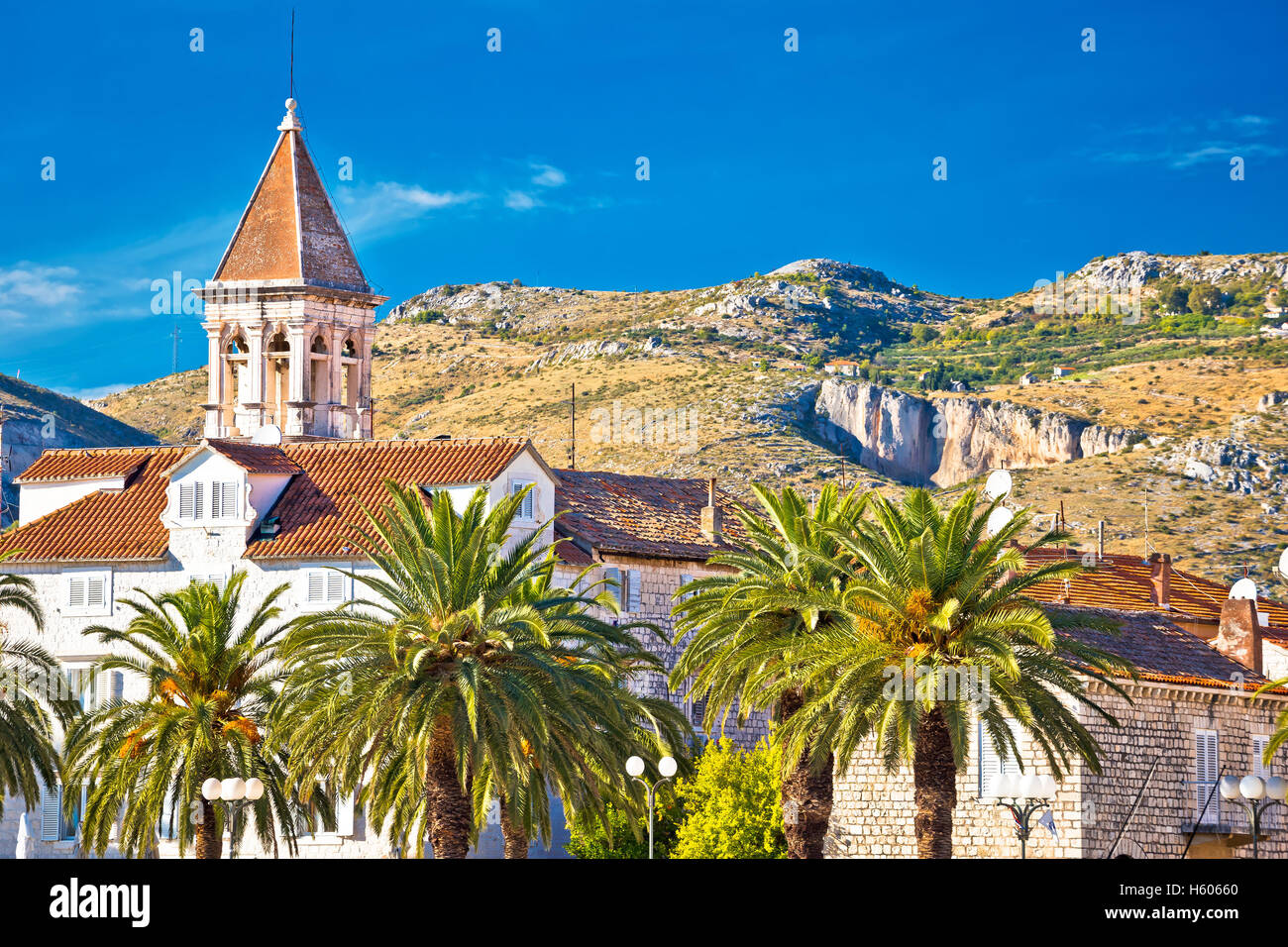 Trogir landmarks and mountain cliffs background, UNESCO town in Croatia - Stock Image