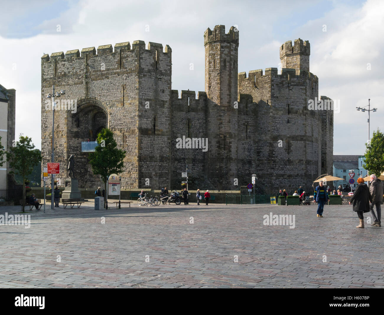 View across Castle Square pedstrianised town centre  to Caernarfon Castle Gwynedd North Wales Caernarfon is a  royal Stock Photo