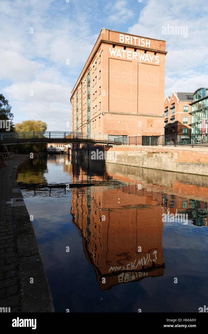 Nottingham British Waterways building reflected in the canal. - Stock Image