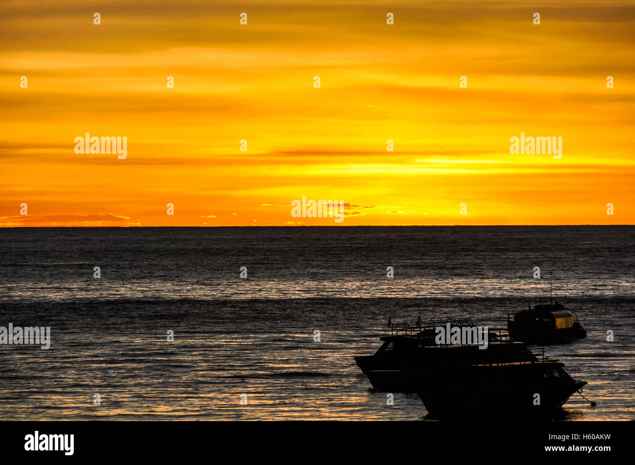 Colorful sunset from the shore of Lake Titicaca in Copacabana, Peru Stock Photo