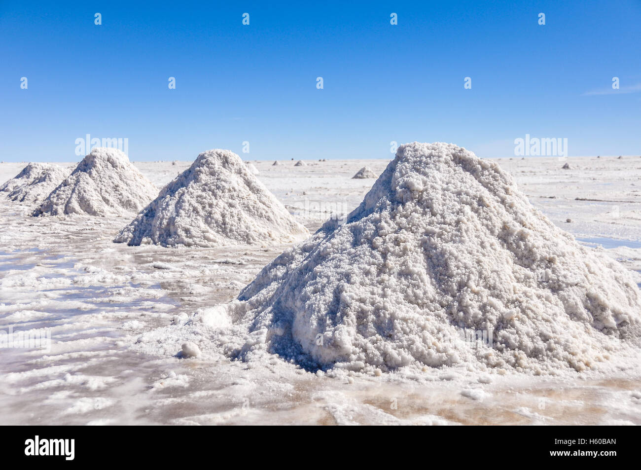 Piles of salt in Salar de Uyuni, the biggest salt flat in the world, Bolivia - Stock Image