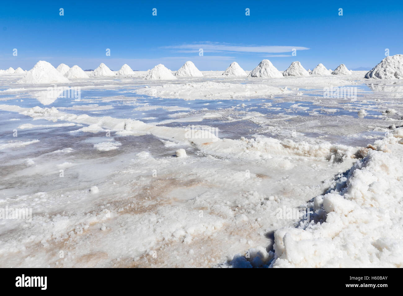 Piles of salt in Salar de Uyuni, the biggest salt flat in the world, Bolivia - Stock Image