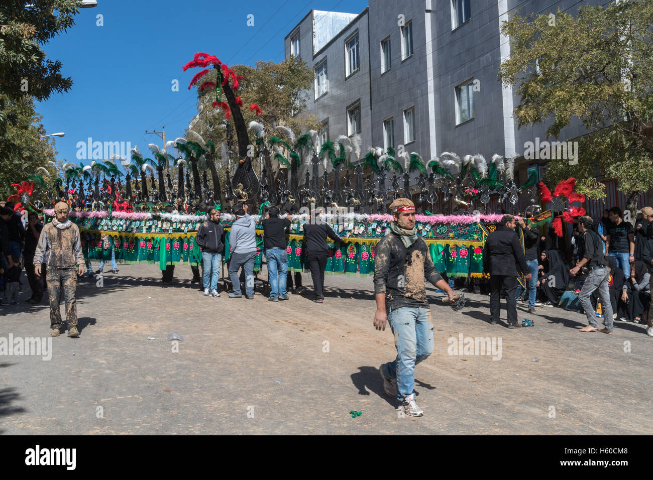 10 Muharram (Ashura), Bijar, Men Carrying Alam During Procession - Stock Image