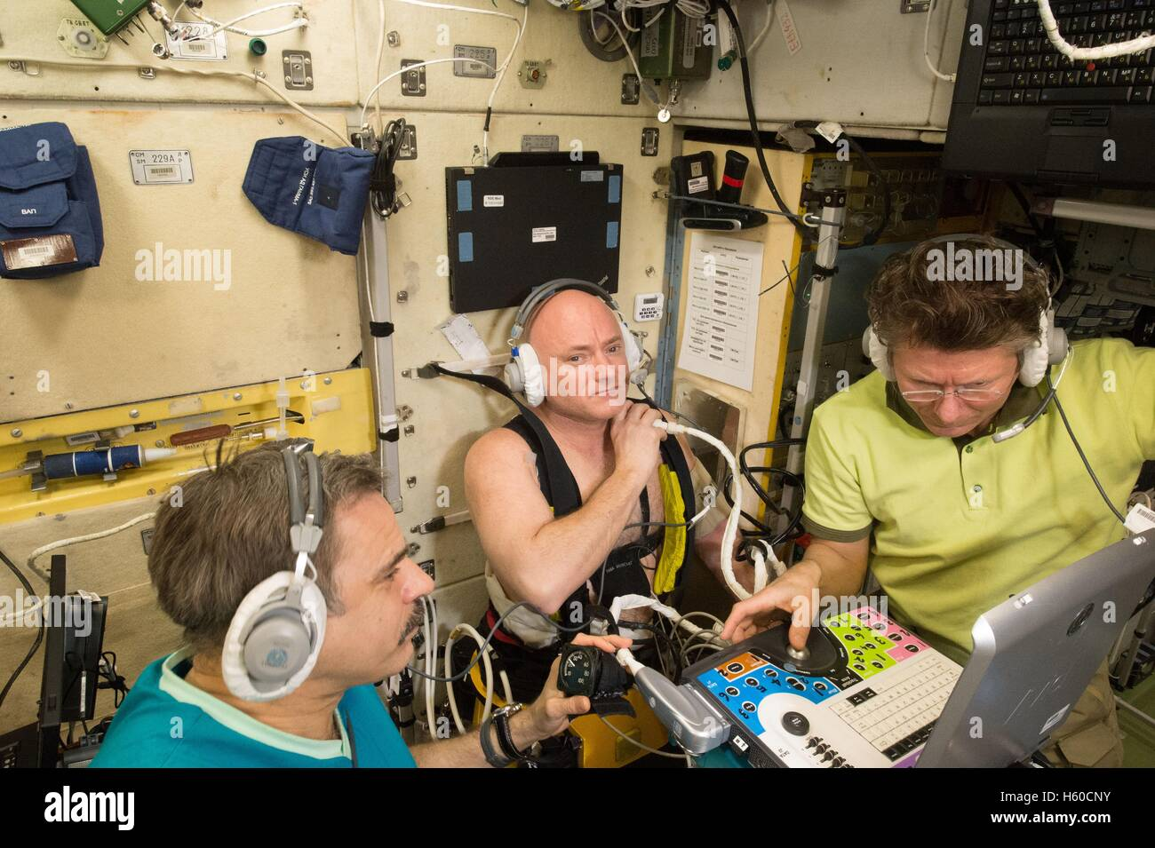 NASA International Space Station Expedition 44 mission prime crew astronaut Scott Kelly (middle) uses a Lower Body - Stock Image