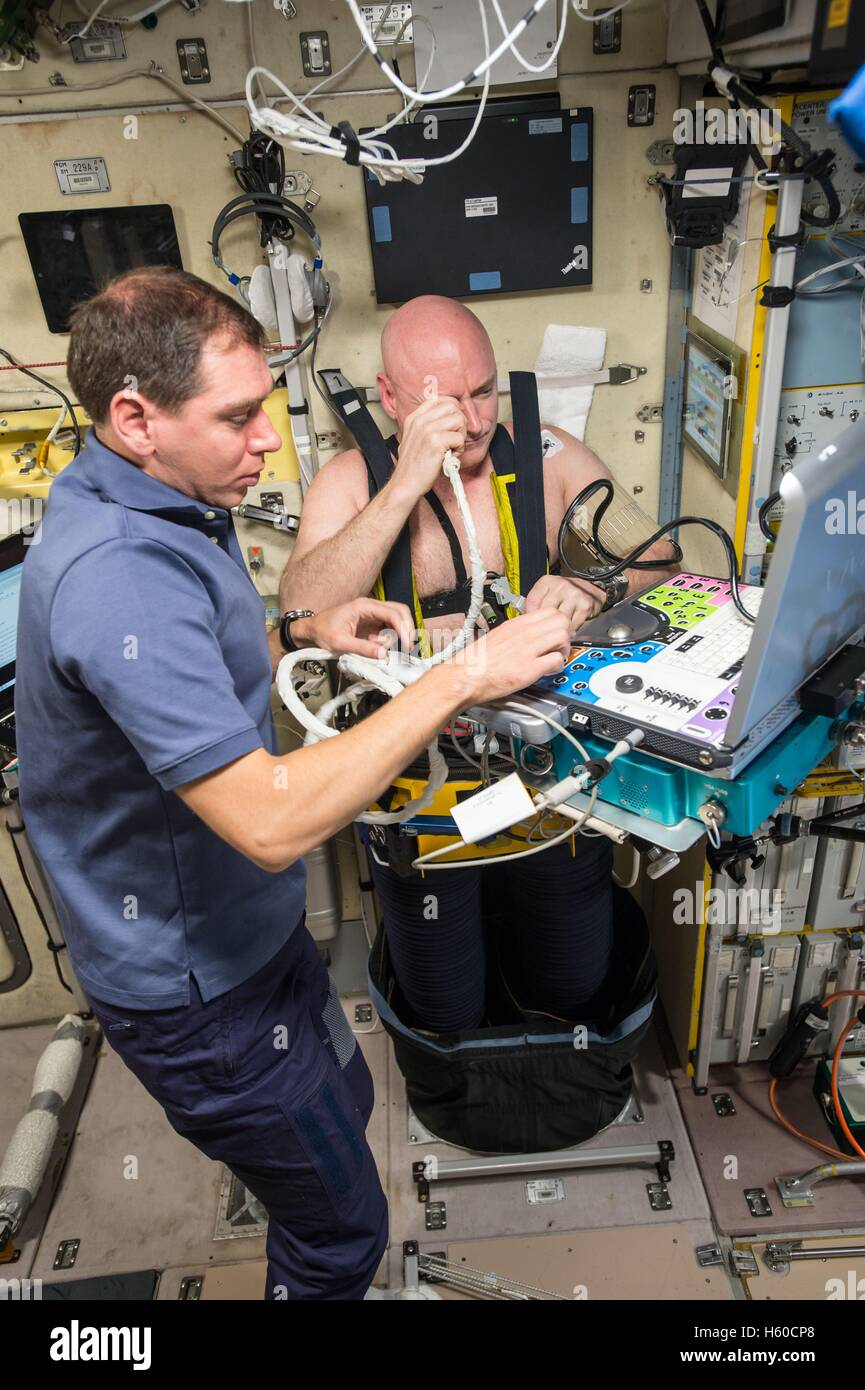 NASA International Space Station Expedition 44 mission prime crew astronaut Scott Kelly (right) uses a Lower Body - Stock Image