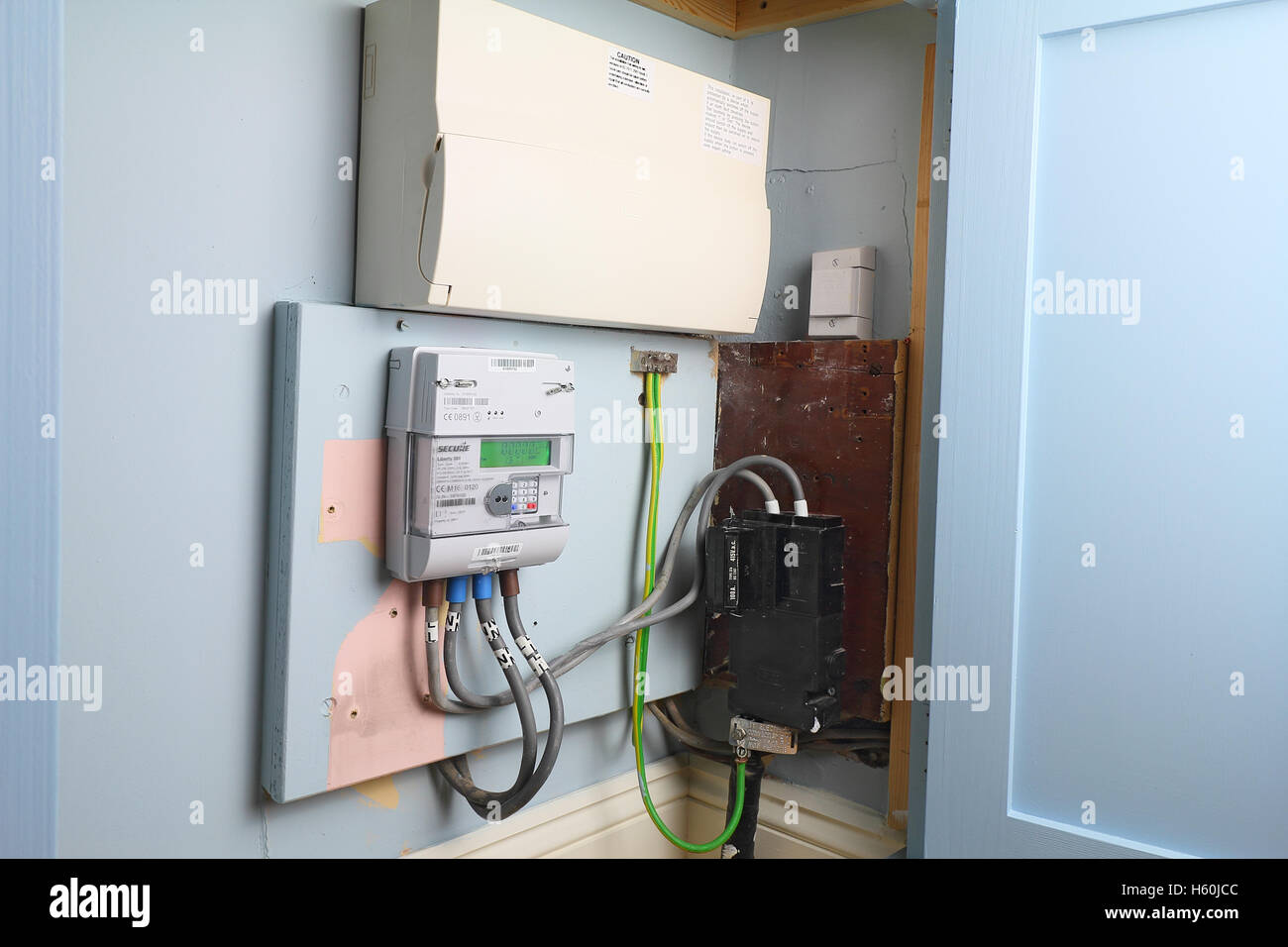 Smart electricity meter can be read remotely and supply real time information to the home owner - Stock Image