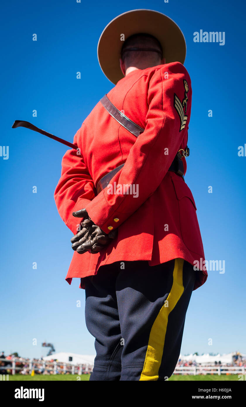 Royal Canadian Mounted Police Officer stands during a ceremony in Minto, Ontario, Canada - Stock Image