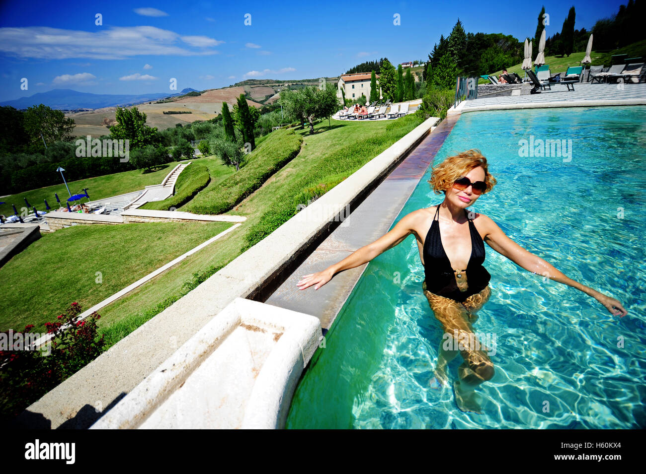 Woman relaxing in the thermal outdoor pool of the Fonteverde Natural ...