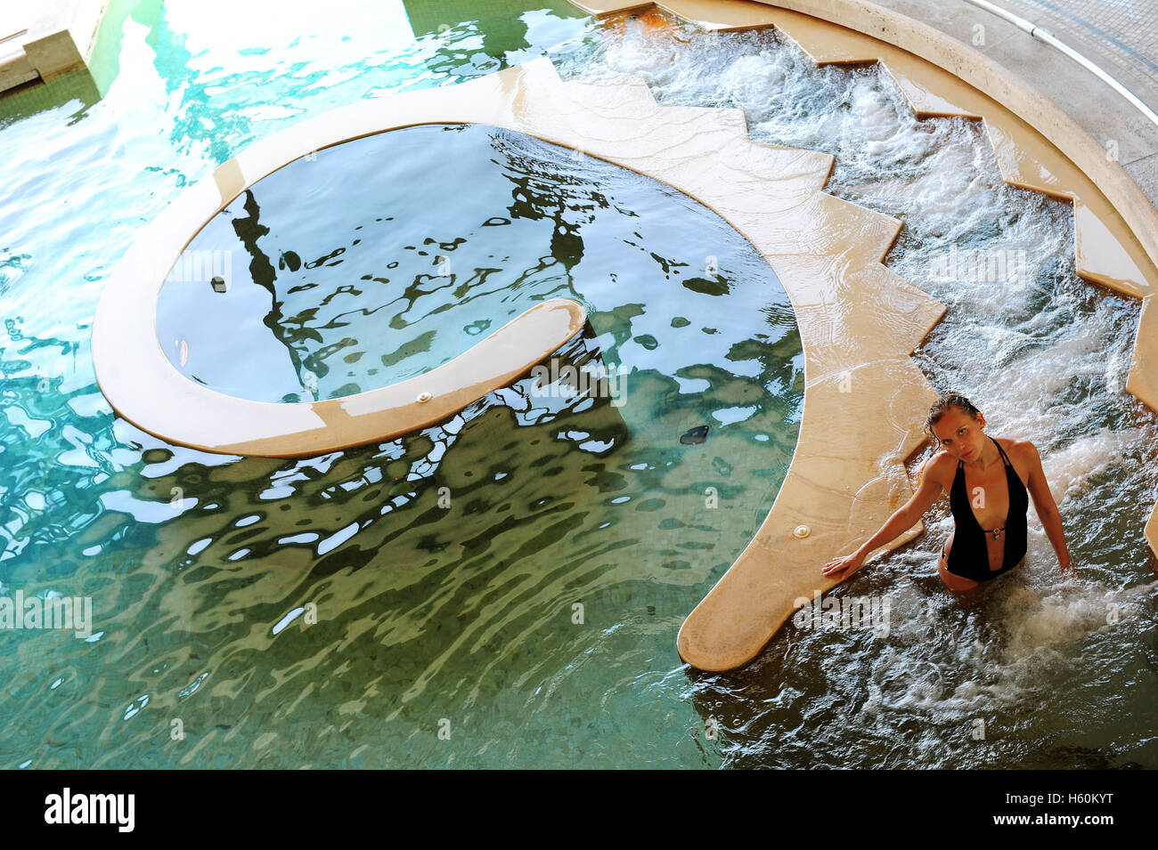 https://c8.alamy.com/comp/H60KYT/a-young-woman-in-the-thermal-indoor-pool-of-the-fonteverde-natural-H60KYT.jpg