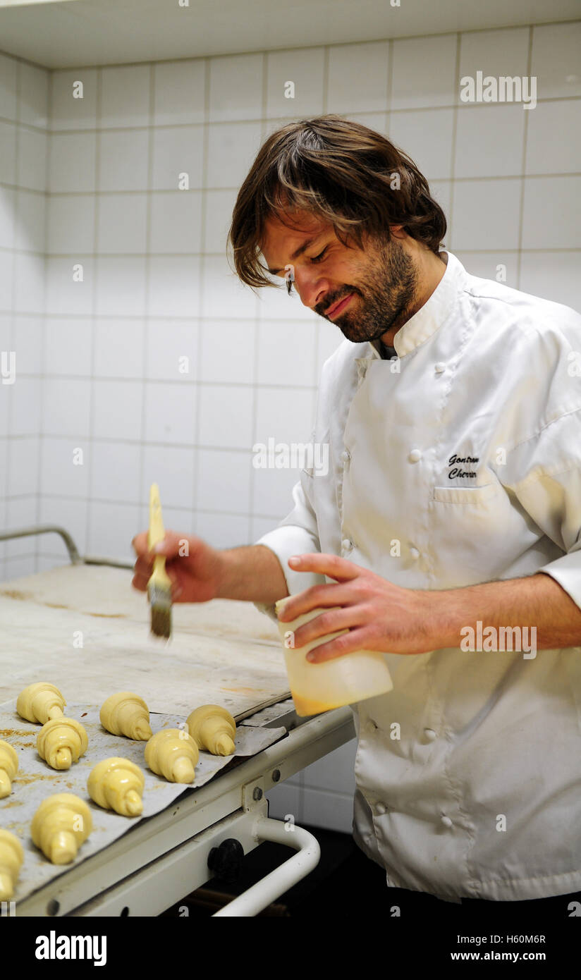 Gontran Cherrier at work in the lab of his bakery in Montmartre, Paris. - Stock Image