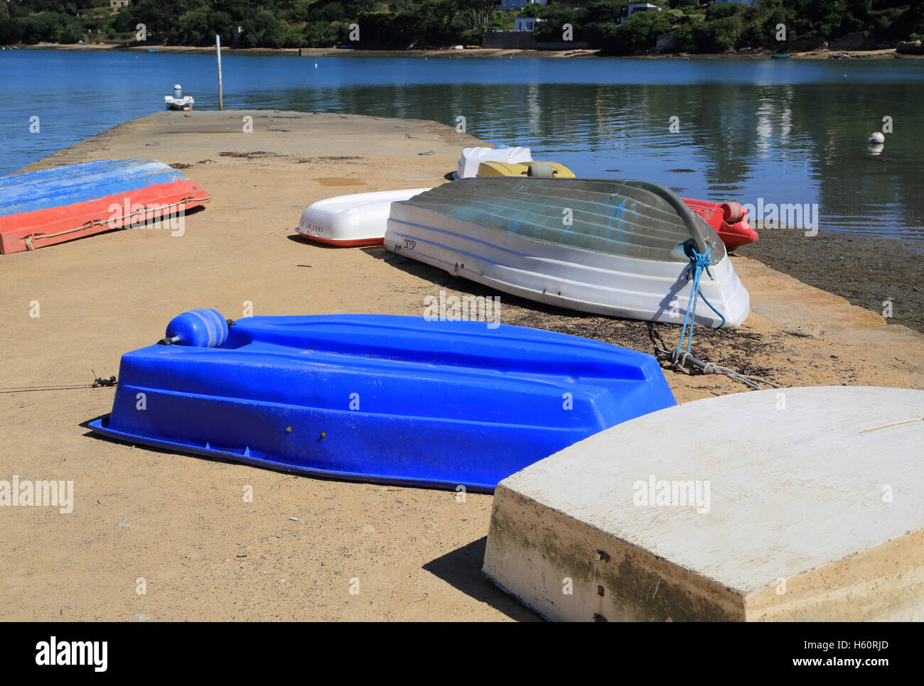 Upturned rowing boats on slipway at Rue Benoni Praud, Ile Aux Moines, Morbihan, Brittany, France - Stock Image