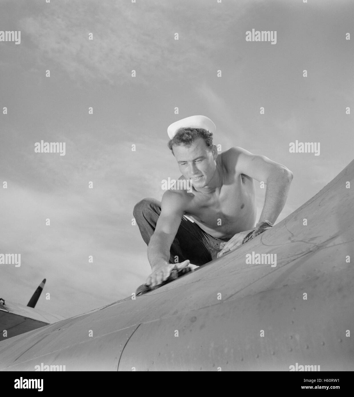 Aviation Machinist's Mate, 2nd Class, Keeping Airplane in Top Condition at Naval Air Base, Corpus Christi, Texas, - Stock Image