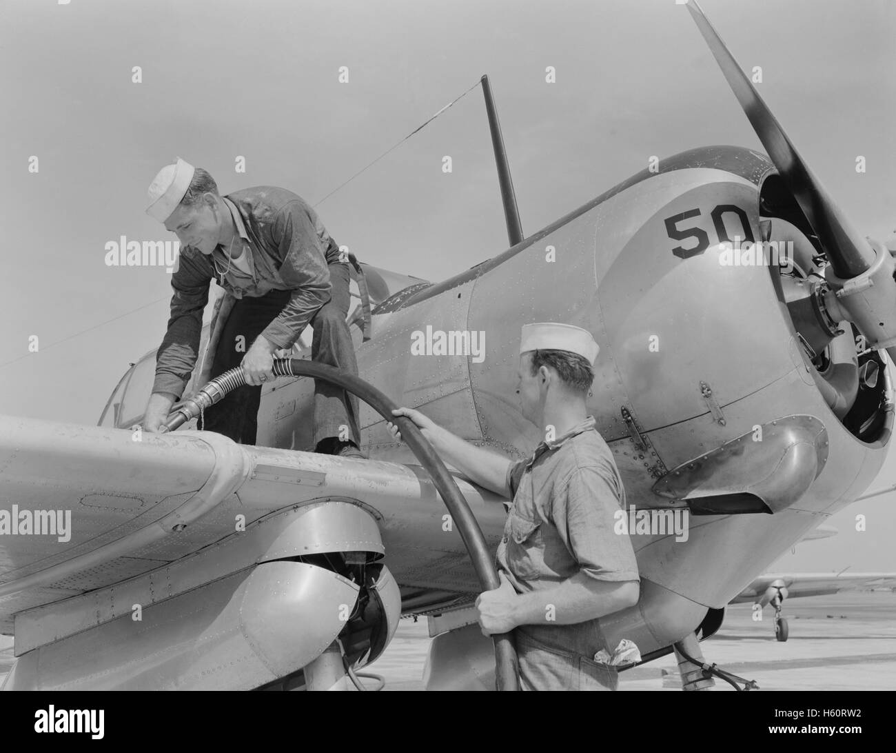 Sailor Mechanics Filling Plane with Gasoline at Naval Air Base, Corpus Christi, USA, Howard R. Hollem for Office - Stock Image
