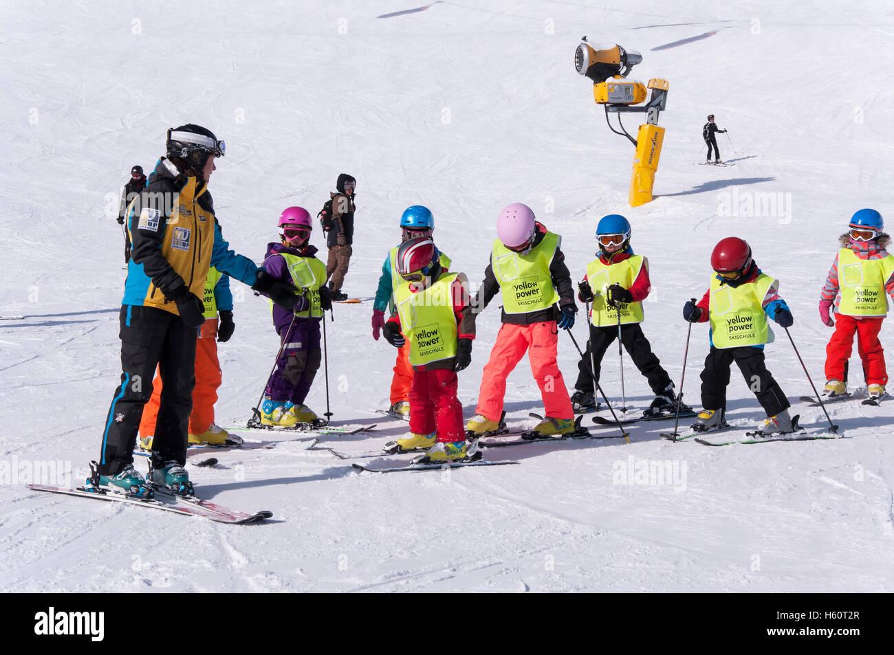 SOLDEN, AUSTRIA, MARCH 4, 2016: Ski school for children in Solden ski resort in Austrian Alps Stock Photo