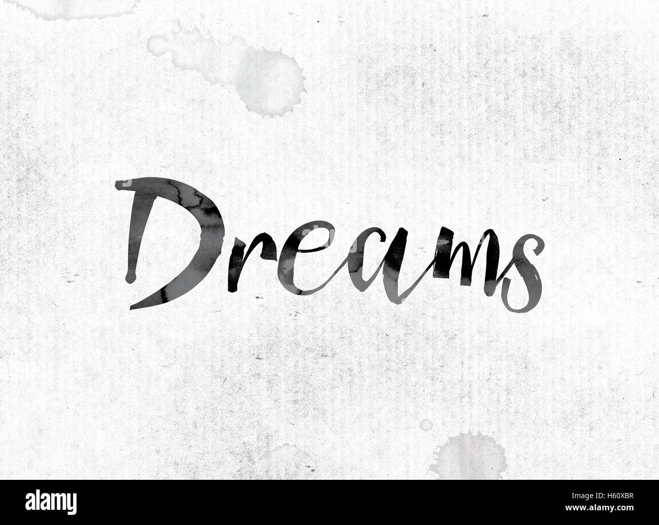 The Word Dreams Concept And Theme Painted In Watercolor Ink On A White Paper