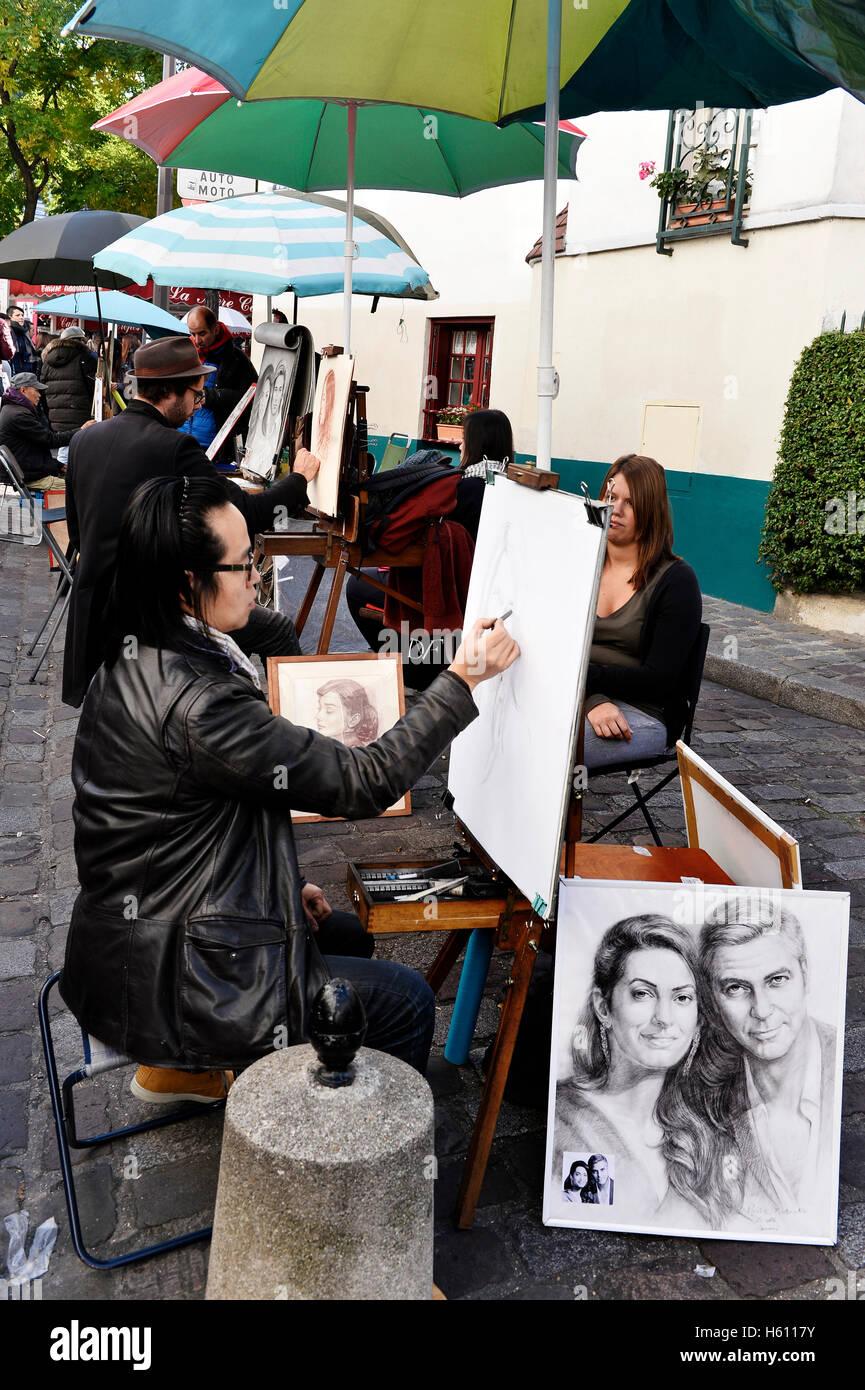 Portrait painter in Place du Tertre, Montmartre, Paris, France - Stock Image