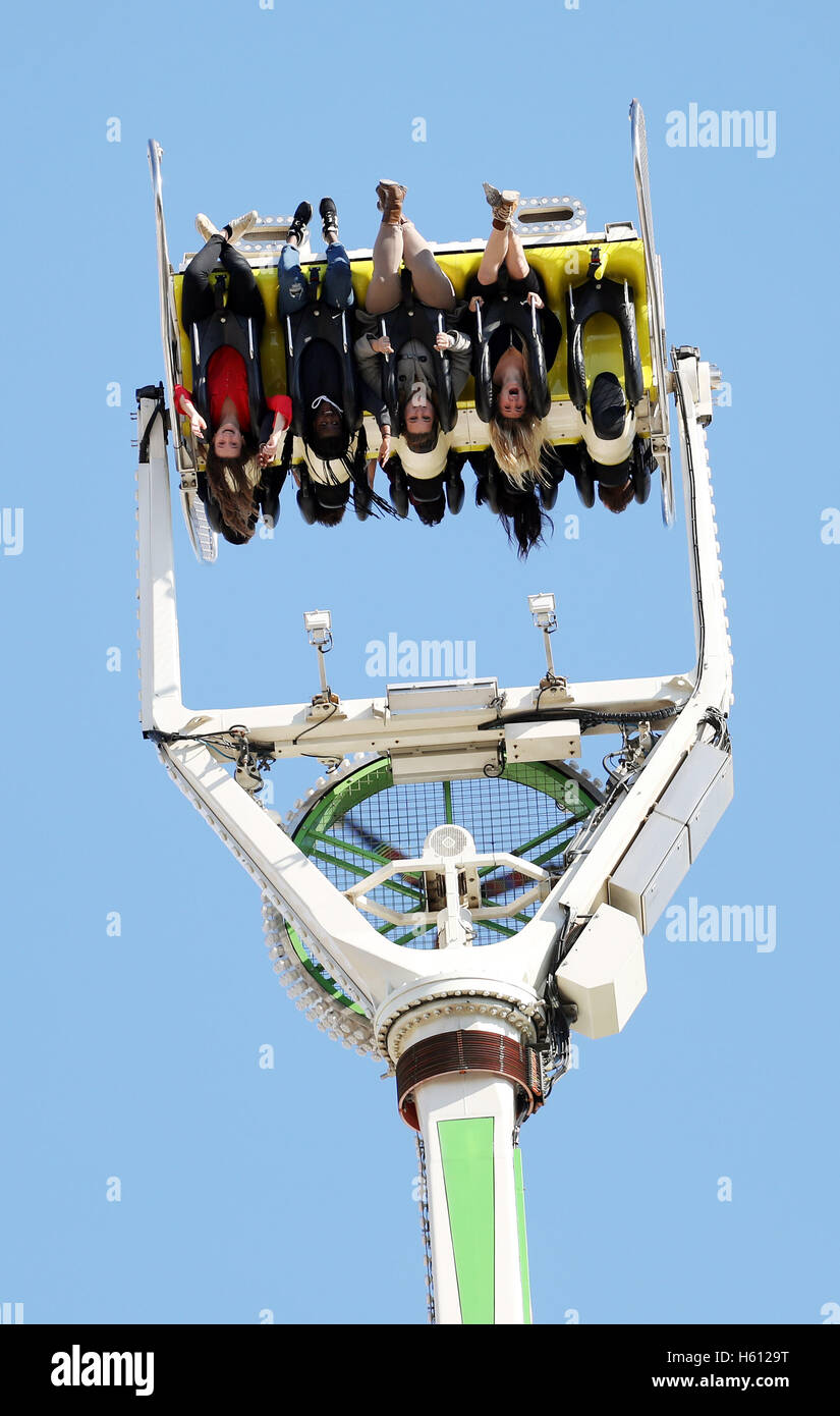 fairground ride thrill seekers youngsters theme park - Stock Image