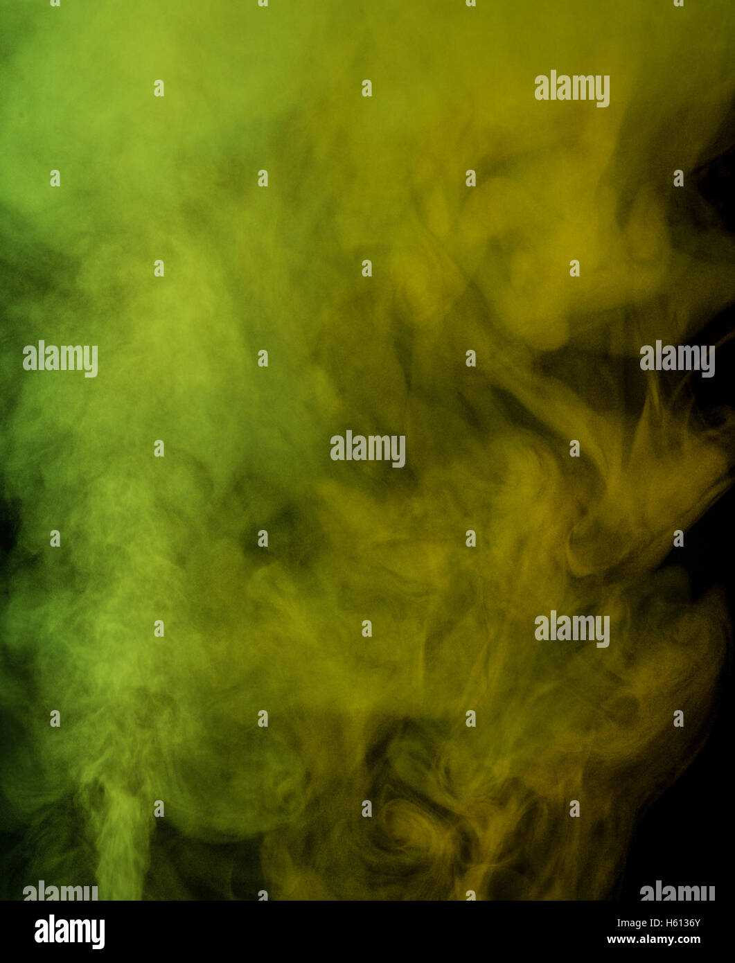 Abstract green yellow water vapor on a black background. Texture. Design elements. Abstract art. Steam the humidifier. - Stock Image