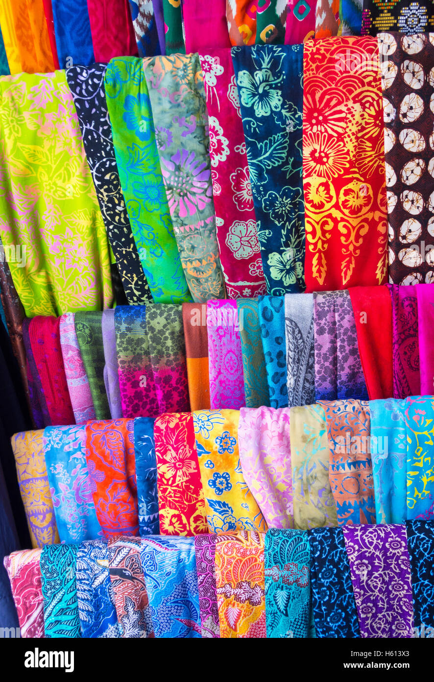 Colorful sarongs on sale in the market at Ubud in Bali, Indonesia. - Stock Image