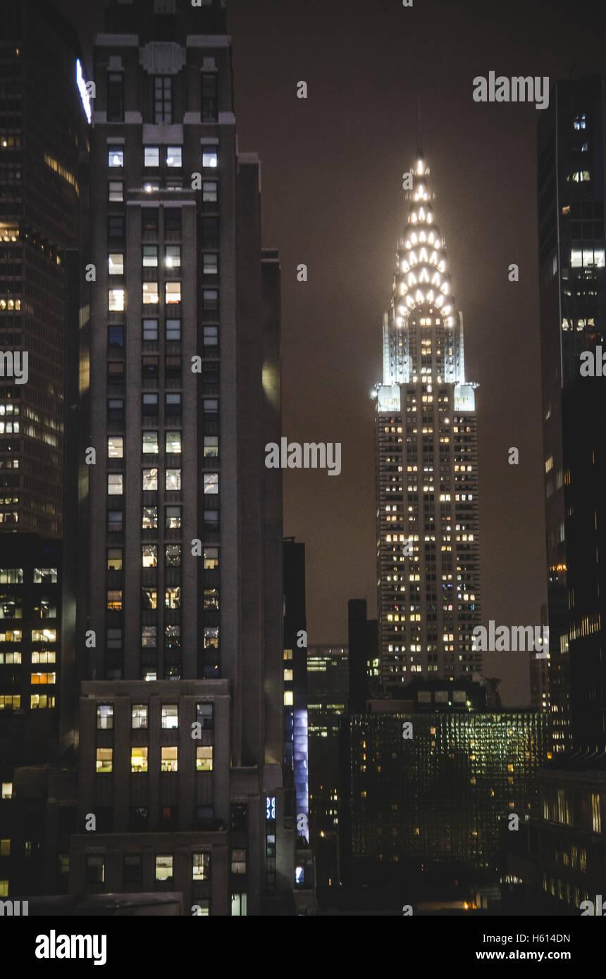 View of Chrysler Building Illuminated at Night, New York City, New York, USA - Stock Image