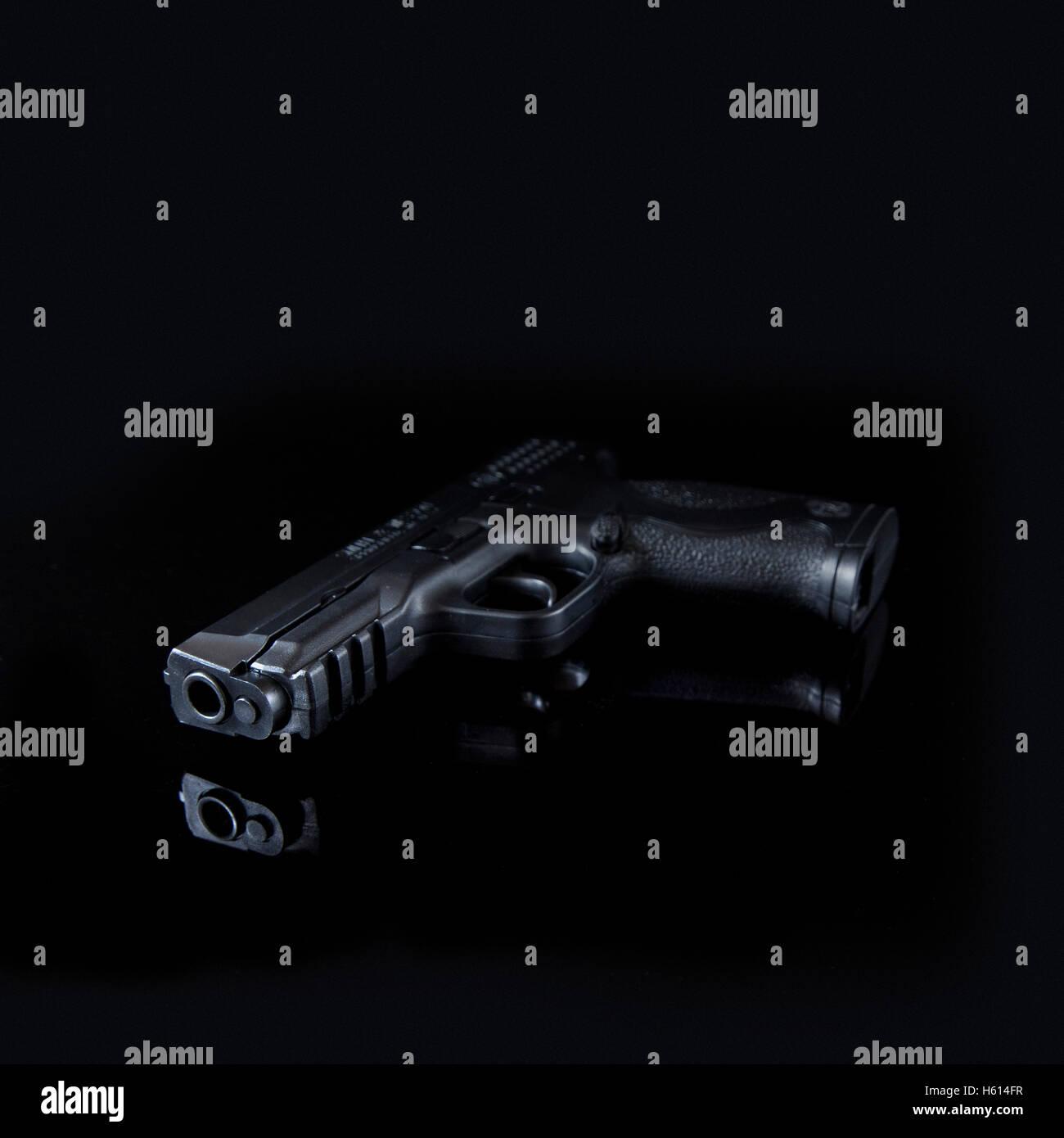 Handgun on Black Background - Stock Image