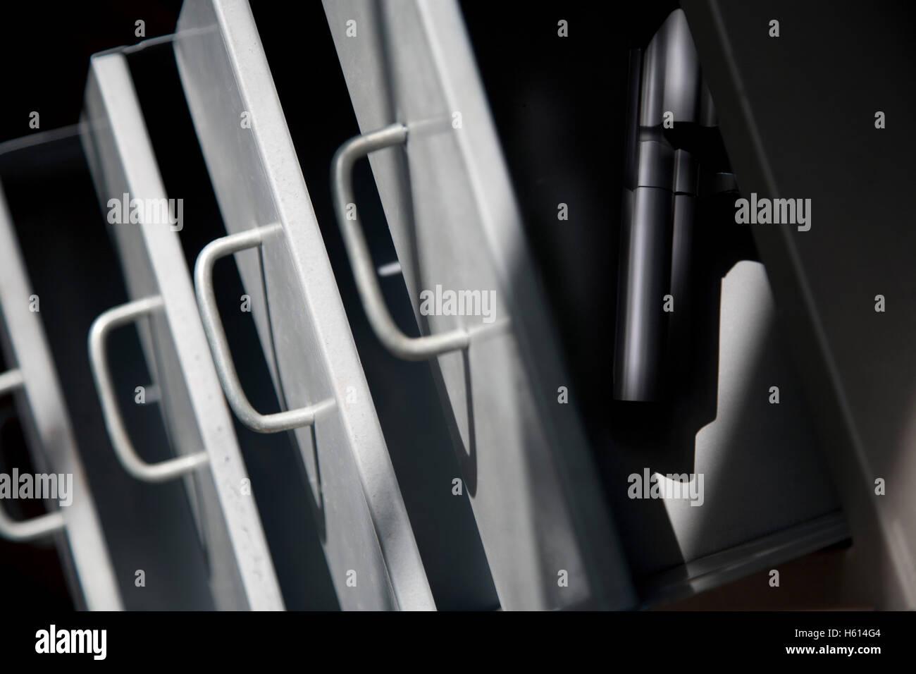 Handgun in Top Drawer - Stock Image