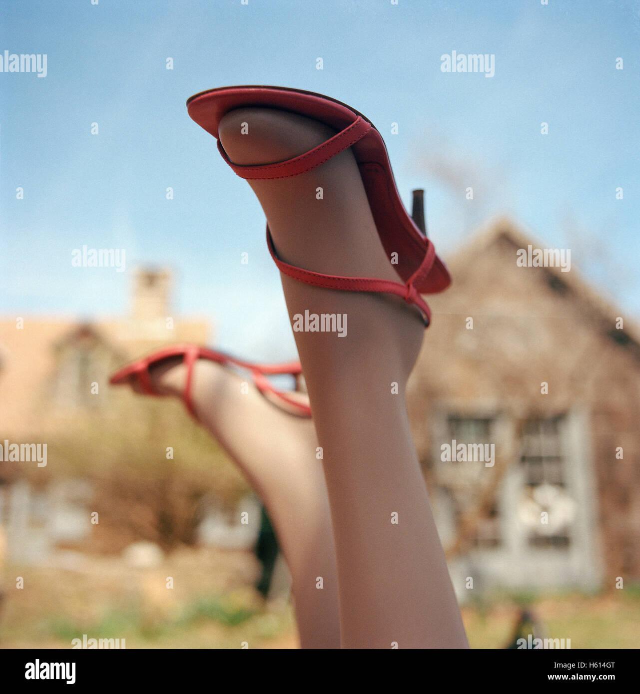 Pink High Heels on Mannequin Upside Down - Stock Image