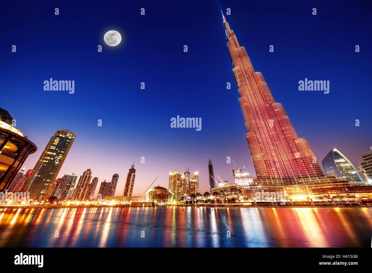 DUBAI, UAE - FEBRUARY 17: Burj Khalifa and fountain - world's tallest tower at 828m at night with moon light - Stock Image