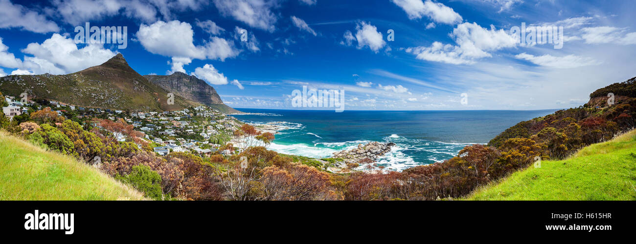 Cape Town panoramic landscape, Camp's Bay and Lion's Head mountain, coastal city between mountains, South - Stock Image